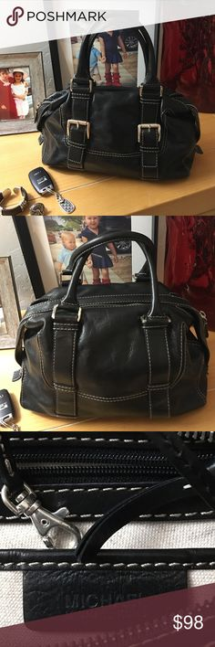 "Michael Kors black leather purse I am offering an old school style Michael Kors purse. It has been ever so gently worn there are signs of wear on the hardware.  For the lady that likes to carry her bag on the arm this is for you.  Width 14 1/2""length 8"" strap 15"" Michael Kors Bags"