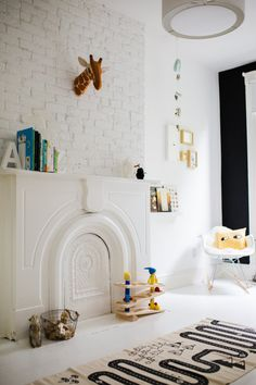 Fill in fireplace with board (could make magnetic chalkboard)