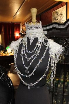 Collar of crystals on collar and epaulettes of leather and lace