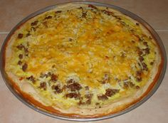 BEST BREAKFAST PIZZA RECIPE. I make the dough from Pillsbury refrigerated crescent rolls. Put the triangles in the pizza pan and pat together to form crust.