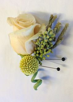 Rustic peach rose boutonniere with yellow craspedia, eucalyptus berry and brunia stems. Boutonniere by Seasonal Celebrations. http://www.seasonalcelebrations.com