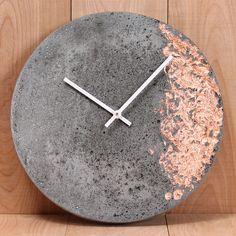 "Lightweight cast concrete 11"" wall clock with inlaid copper, silver or gold foil. Made in Canada."