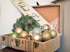 fill a vintage suitcase with ornaments
