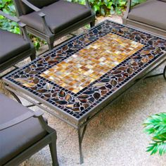 Create a beautiful centerpiece for your conversations and entertaining with our mosaic Coffee Chat table. This expertly crafted mosaic design features hand laid tumbled marble and stained glass, se...