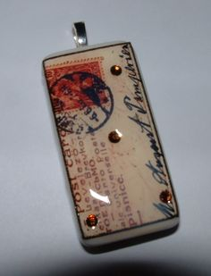 Altered Art Domino Charm Pendant Vintage Foreign by b3studio. $12.50, via Etsy.