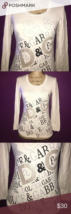 Dolce & Gabbana white black & silver Tshirt Dolce & Gabbana white black & silver Tshirt **MAKE ME AN OFFER** Dolce & Gabbana Tops Tees - Long Sleeve