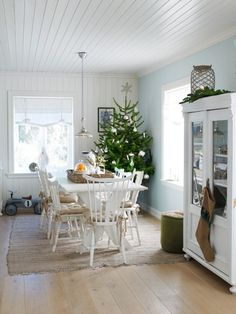 someday I would love a Christmas tree in a white washed dining room...