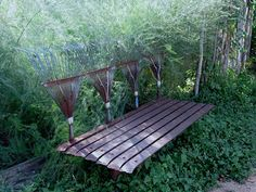 ~~~ Sharon Lovejoy-This bench is made of old metal rakes. I found this at The Natural Gardener in Austin, Texas, which is a MUST SEE place if you love the garden.