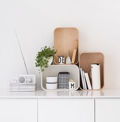 White and wood storage containers and Tivoli radio in the kitchen of the fabulous Finnish home of Maja / Musta Ovi.
