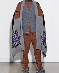 Fabulous Blanket or Cape with different fabrics or prints instead of a Jacket or coat...  Look by: Sacai FW2014. Subjective and classy statements, looking great for fall. Also very original