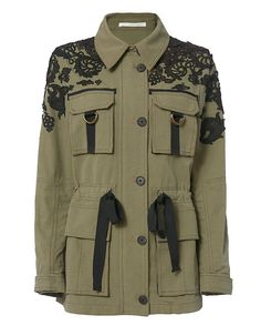 Veronica Beard Heritage Utility Jacket: The utility jacket updated with embroidery fuses function and fashion. Four flap cargo pockets. Button closures at front and self tie drawstring at waistline. Button tabs at long sleeve cuffs. In army. Fabric: 100% cotton Imported. Model Measurements: ...
