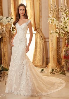 Classic Embroidered Lace on Soft Tulle with Scalloped Hemline Wedding Dress Designed by Madeline Gardner.