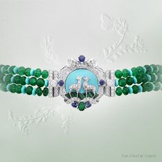 """Clasp of Van Cleef & Arpels Biches necklace, """"Peau d'Âne raconté par Van Cleef & Arpels"""" collection. White gold, round diamonds, round and pear-shaped sapphires, malachite, turquoise, one pear-shaped emerald, 188 emerald beads for a total of 555.37 carats (origin: Afghanistan)."""