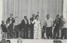 A great photograph full of Blues legends from the 1962 American Folk Blues Festival. From Left to Right: Memphis Slim, T-Bone Walker, Shakey Jake, Willie Dixon, Helen Humes, Sonny Terry, John Lee Hooker and Brownie McGhee. (photo by Heinz Wolf)