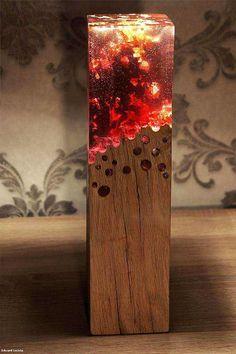 A wood lamp made with acrylic glass looks like it's burning - Imgur
