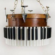 If you're considering recycling a piano and think you will need to remove the keys, don't toss them in the trash! Instead, use them to create a chandelier.