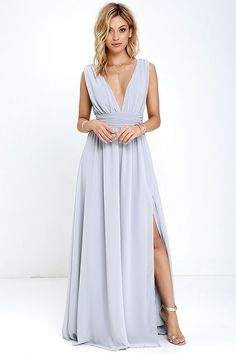 You'll be goddess-like for the entire evening in the Heavenly Hues Light Grey Maxi Dress! Georgette fabric drapes alongside a V-neck and back, and lays across a banded waist. Full maxi skirt has a sexy side slit. Hidden back zipper with clasp.