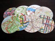 Coasters made out of maps; could use travel brochures, book pages, etc instead