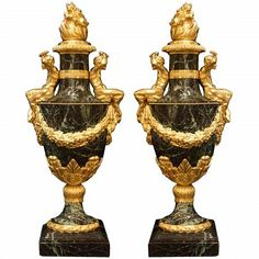 A magnificent pair of French late 19th century Neo-Classical st. solid Lavanto Rouge marble and ormolu urns. Each high quality urn is raised on a mottled square base below the marble socle with ormolu wreath trim and acanthus leaf border. The highly chased ormolu continues on the urn with large leaves below a swaging floral garland. At the neck of the urn is a central ormolu band flanked by seated ormolu Satyr figures. All below the impressive removable ormolu lid with flame of prosperity…