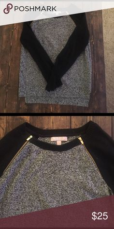 Banana Republic sweater black and gray banana republic sweater. It's a little bit longer in the back than the front and has gold zippers on top front. Looks great with collared shirt underneath or alone. size small. like new. Banana Republic Sweaters Crew & Scoop Necks