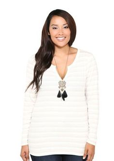 Don't shy away from white! This long-sleeve top with its V neck and lean shape is super flattering. Plus that statement necklace really pops against it.