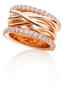 """This potent gesture of subtle elegance also pervades the ring shown in CAPOLAVOR's """"Magnifico"""" Set, which is a vibrant manifestation of superabundant sensuality set in red gold. The rhythm emanates from multiple flowing layers of gold that encircle the finger of the wearer like exquisite gossamer, clasped and sustained by two diamond-studded ring elements."""