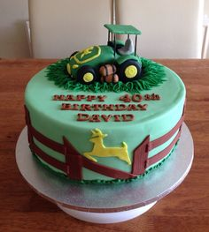Farmers theme birthday cake with a John Deere green tractor as cake topper