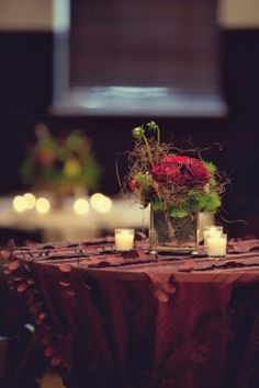Three small versions on each table; several votive candles on each as well. Goes with the centerpieces showed in the reception area