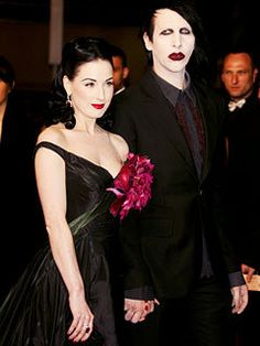 Burlesque artist Dita von Teese and musician Marilyn Manson attend the 'Southland Tales' premiere at the Palais during the 59th International Cannes Film Festival May 21, 2006 in Cannes, France.