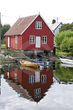 Red house in a fishing village in norway for Norway wooden houses