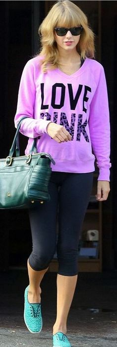 Who made Taylor Swifts pink sweatshirt, green handbag, black sunglasses, and sneakers?