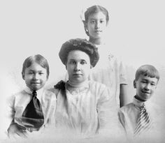 Agnes T. Anderson with 3 of 4 children, Chicago, 1913. Born in Sweden, 1878. Married in 1897 to Harley T. Moy, native of Sunning (Taishan) China. The tallest child is Helen, born 1901 in Lowell, IN. NARA Exclusion Files photo