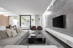 In this living area, a material palette of stone, concrete and metal has been used to create a cool contemporary look and feel. Living Room Tv, Home And Living, Living Area, Living Spaces, Modern Living, House Rooms, Cheap Home Decor, Home Interior Design, Living Room Designs