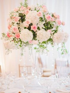 Photographer: Pasha Belman Photography; Glamorous white and pink floral wedding reception centerpiece;