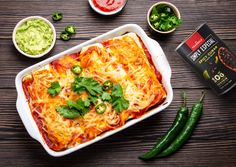 This delicious Chicken Black Bean Enchiladas Freezer Meal is perfect for taking dinner to a friend or having prepared for a last minute meal! Mexican Enchiladas, Black Bean Enchiladas, Cheesy Chicken Enchiladas, Veggie Recipes, Lunch Recipes, Chicken Recipes, Cooking Recipes, Easy Recipes, Freezer Friendly Meals