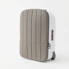 Japanese studio Nendo has designed a cabin-size suitcase with a fabric lid that unzips from the top and rolls back to the side for easier access