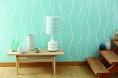 Absolutely adore this powder blue wallpaper! It would look perfect in a beach-side apartment.