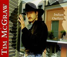 Tim McGraw, Indian Outlaw.   Yup, I have been listening to him since this album came out...!