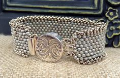 ~ Antique Silver Chic ~ Wear alone or with your favorite bracelets or watch. This piece will complete your look. This peyote stitch bracelet