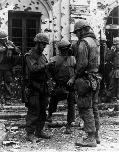 """""""Marines of the Second Platoon, Foxtrot Company 2/5, light up after securing a battle scarred building during the Battle of Hue."""" (1968)"""