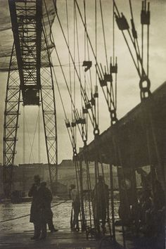 moholy-nagy, lászló ||  Pont Transbordeur im Regen, Marseille, is one of a number of photographs made by Moholy-Nagy in 1929 in the Mediterranean port city.  The previous year, the art historian Sigfried Giedion, a close friend of Moholy-Nagy, published Bauen in Frankreich, Bauen in Eisen, Bauen in Eisenbeton, illustrating Marseille's transporter bridge on the dust-jacket.  The bridge, built nearly a quarter century before, became an icon of modernity and attracted not only Moholy-Nagy, but…