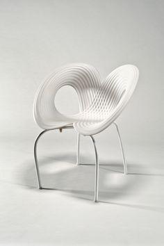 Artist/Designer: Ron Arad b. 1951, Tel Aviv Title: Ripple chair, 2005. Hand signed by Ron Arad in black on back, left side. Medium: Polypropylene shell with white powder coated legs, polyethylene glid