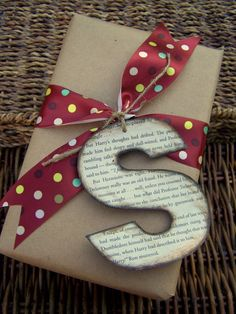 "Made a really cute giant letter ""S"" for a Christmas present tag.  I printed out the letter in the font and size I wanted, then traced it onto a cereal box.  Then I traced scrapbook paper to cover the letter and decoupaged it on top.  I embellished it a little with glitter.  It was gorgeous, but a lot of work for something I know was going into the trash once the present was opened."