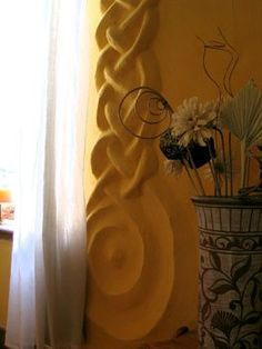 Celtic knot work done in plaster. One of many interior detailed designs you can incorporate in your earthen home.