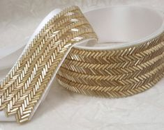 This lovely beaded trim wraps you in the warm elegance of gold! -beaded trim measures inches wide x 18 inches long* -finished ribbon belt measures inches long x 108 inches long *shown on 24 waist mannequin You may also like: Wedding Belts, Wedding Sash, Bridal Sash, Gold Wedding, Bead Embroidery Patterns, Hand Embroidery Designs, Beaded Embroidery, Bridesmaid Belt, Gold Bridesmaids