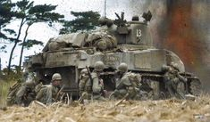 M4 Sherman (US Army 3099276) of 'A' Company 763rd Tank Battalion and troops from the 96th Infantry Division in battle at Okinawa, April 1945