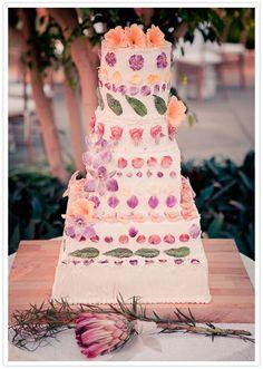 Such a colorfully sweet #weddingcake! From http://100layercake.com/blog/2012/09/05/free-people-wedding-gianna-jeremy/  Photo Credit: Gary Ashley http://theweddingac.com/categories/photography/gary-ashley#!/image_11260 Cake by Joe Moorhead http://internationalculinarycenter.com/explore/bios/ny/pastry_chefs/joseph_moorhead/