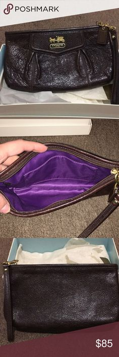"Brown Coach wristlet in great condition! Authentic brown leather coach wristlet. Measures 8"" long and 3"" high. Purple interior. Comes with the original box. Coach Bags Clutches & Wristlets"