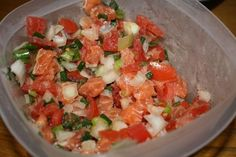 "Hawaiian Lomi Lomi Salmon. It's not quite ""ceviche""--since there is no lime juice in the recipe, but this is one of Hawaii's favorite luau side dishes. It's so refreshing and so delicious! You don't have to be in Hawaii to make this dish. It can be prepared the day before, and refrigerated to let the flavors marry. Enjoy!"