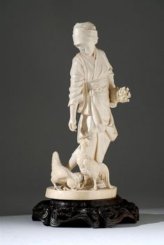 "CARVED IVORY FIGURE Meiji Period In the form of a farm girl in an elaborate kimono feeding roosters and chicks. Signed ""Keiun"". Height 9.75"" (24.76 cm)."